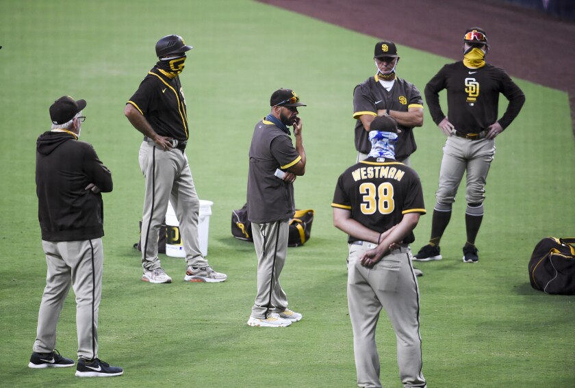 Padres manager Jayce Tingler, center, talks with staff after an intrasquad game on Wednesday.