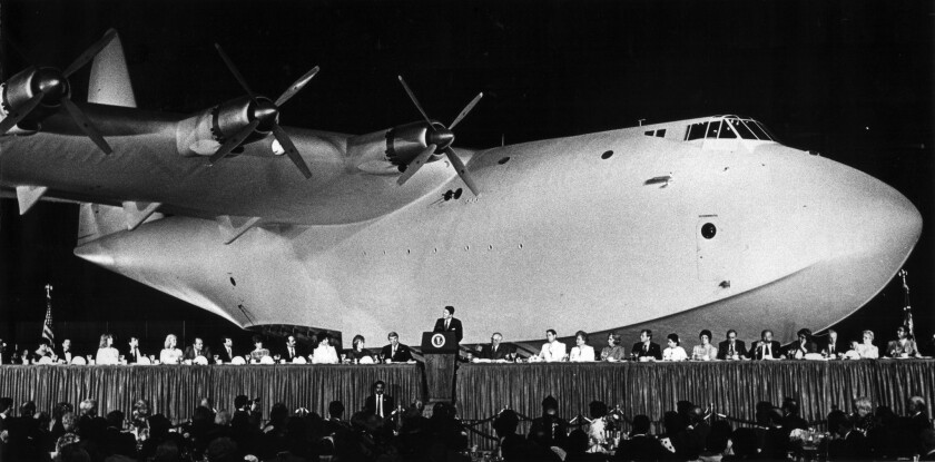 June 30, 1983: With the giant Spruce Goose providing a background, President Reagan addresses a Republican fund-raising dinner.