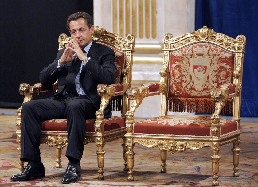 Former French President Nicolas Sarkozy on a throne-like chair