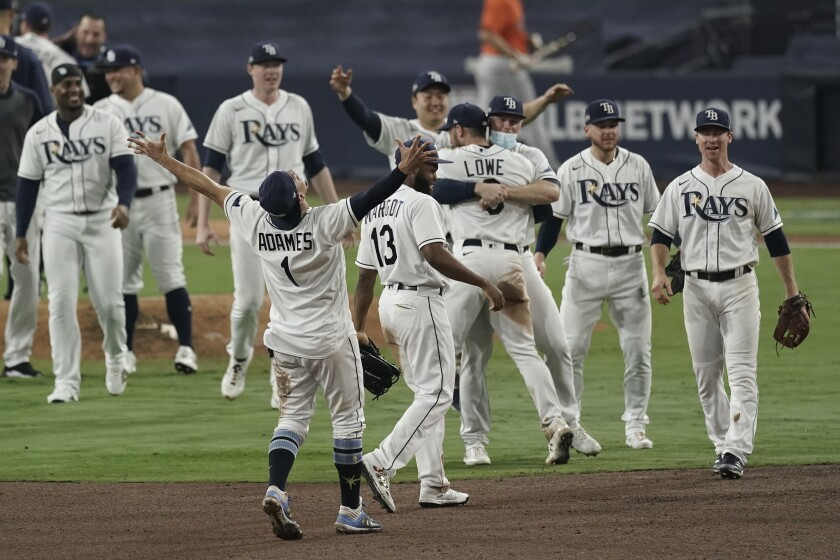 The Tampa Bay Rays celebrate their victory against the Houston Astros in Game 7 of the American League Championship Series.
