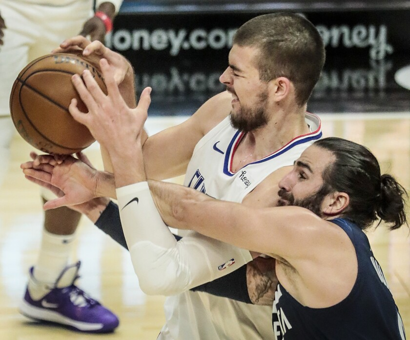 Clippers center Ivica Zubac is fouled by Timberwolves guard Ricky Rubio.