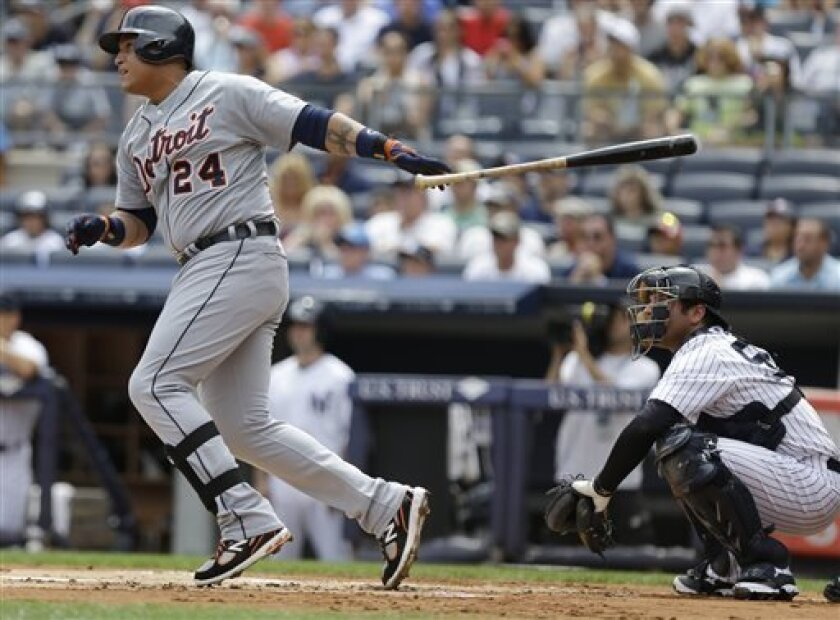 Detroit Tigers' Miguel Cabrera (24) follows through on a single during the first inning of a baseball game New York Yankees catcher Austin Romine looks on Saturday, Aug. 10, 2013, in New York. (AP Photo/Frank Franklin II)