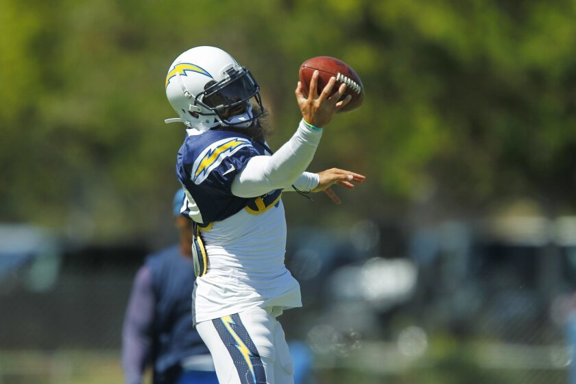 Chargers Eric Weddle makes a catch during practice.