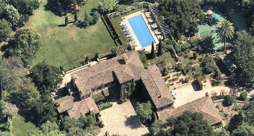 An aerial view of the 7 acre estate in Montecito that includes a guest house, pool, tennis court, gardens and playground