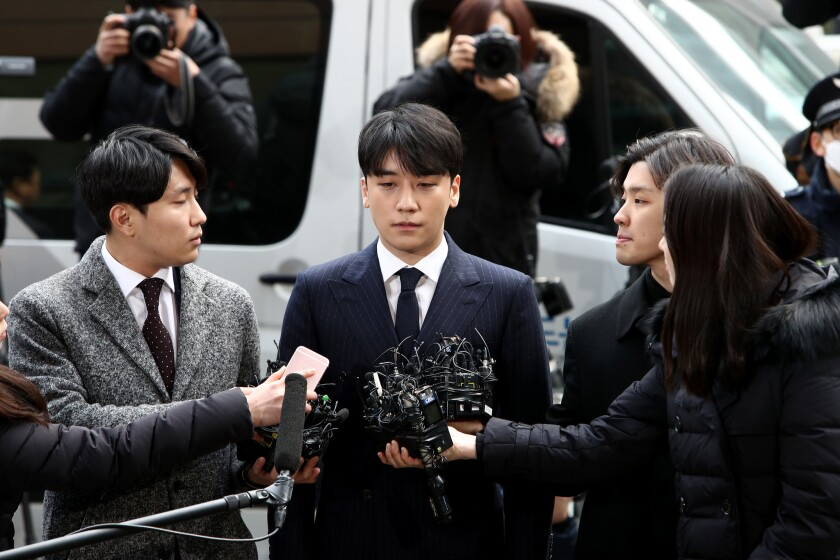 Seungri, formerly a member of South Korean boy band BIGBANG is seen arriving at a Seoul Metropolitan Police Agency on March 14, 2019 in Seoul, South Korea.