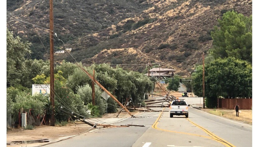 A storm knocked down power poles in Wildomar. (National Weather Service)
