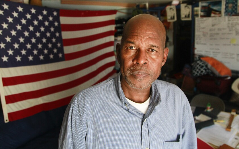 "Roman Sabal, a US Marine veteran who was deported, poses for photos in Tijuana as he waits for his US citizenship interview on July 12, 2019 in Tijuana , Baja California. Sabal is at a facility called ""The Bunker"" in Tijuana, which is a deported veterans support house."