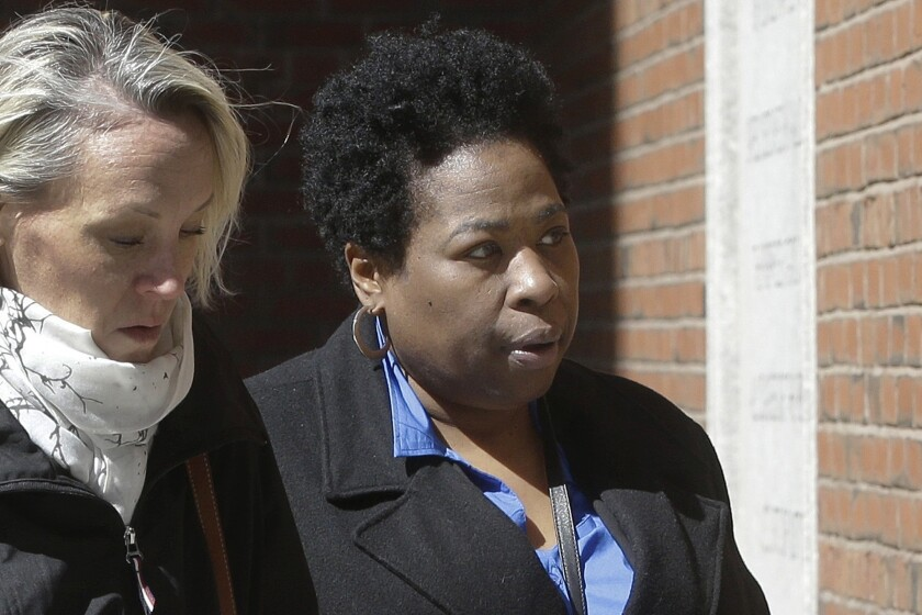 FILE - In this March 25, 2019, file photo, Niki Williams, right, a college entrance exam administrator, arrives at federal court in Boston to face charges in a nationwide college admissions bribery scandal. Williams is scheduled to plead guilty to charges on Friday, Sept. 25, 2020. (AP Photo/Steven Senne, File)