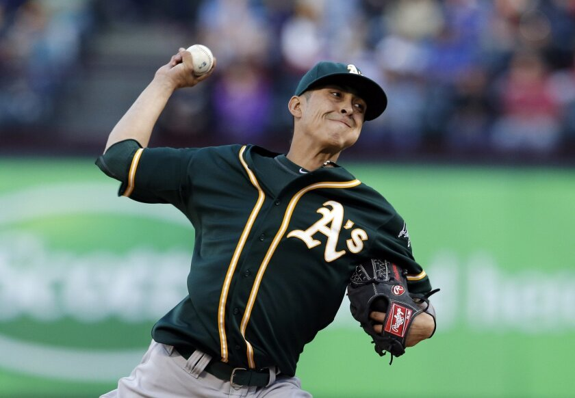 Oakland Athletics' Jesse Chavez delivers to the Texas Rangers in the first inning of a baseball game, Wednesday, April 30, 2014, in Arlington, Texas. (AP Photo/Tony Gutierrez)