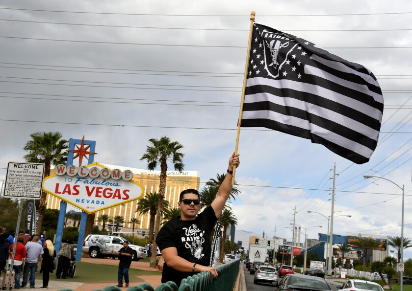 Raiders fan Matt Gutierrez celebrates on March 27, 2017, after NFL owners approved the team's relocation to Las Vegas. The Raiders are set to begin play in their new stadium next season.
