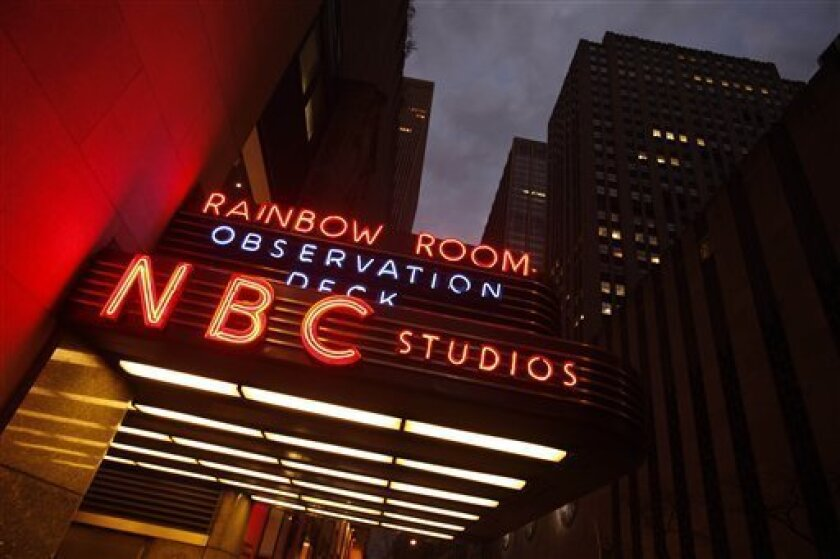 In this photo made Tuesday, Nov. 17, 2009, a marquis advertises the Rainbow Room, the Observation Deck, and NBC Studios at the GE building in New York. General Electric Co.'s agreement to buy out the rest of NBC Universal paves the way for it to sell control of the TV and movie company to Comcast C