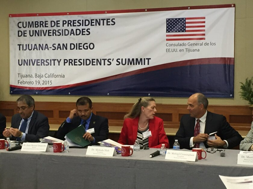 National University president Michael Cunningham, right, speaks with Melinda Nish, superintendent/president of Southwestern Community College during a meeting Thursday in Tijuana aimed at increasing cross-border study opportunities . To the far left is Pradeep Khosla, chancellor of University of California San Diego, and beside him is Juan Manuel Ocegueda, president of the Autonomous University of Baja California.