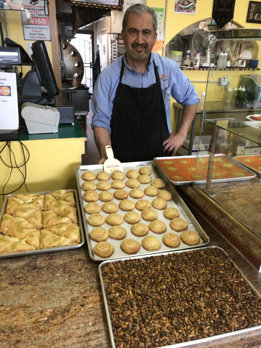 Asem Abusir, owner of Knafeh Café, usually has many large catering orders to fulfill during Ramadan. But this year, without social gatherings, he's offering smaller trays for individual families and opening up deliveries to folks across the nation.
