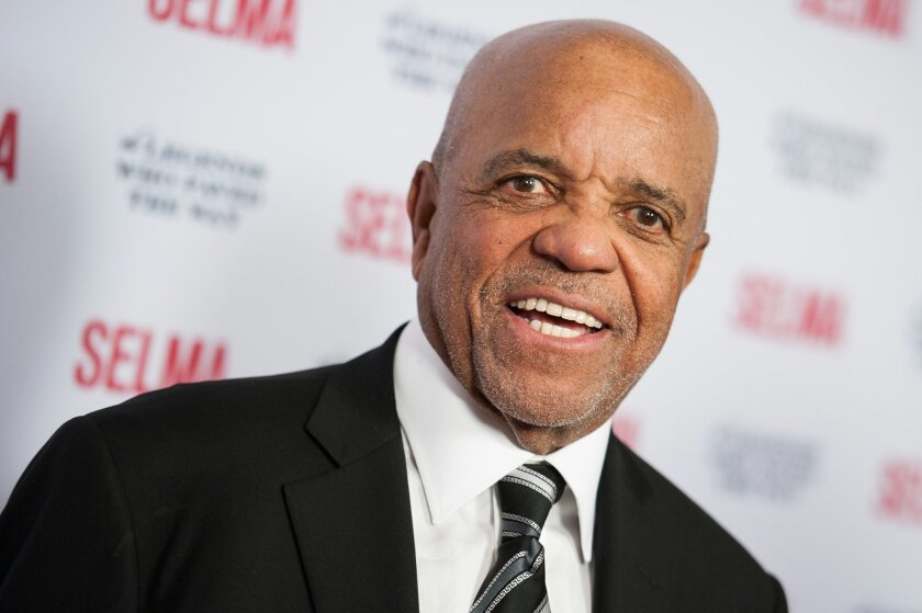 FILE - In a Dec. 6, 2014 file photo, Berry Gordy arrives at Selma And The Legends That Paved The Way Gala, in Goleta, Calif. Producer Kevin McCollum said Monday, Nov. 23, 2015, that the musical that tells the story of how Motown Records rose and fell and then rose again will return to New York starting July 2016 for an 18-week stand. McCollum said the show has gotten stronger since opening cold on Broadway two years ago and Motown Records founder and book writer Berry Gordy has sharpened the story. (Photo by Richard Shotwell/Invision/AP, File)