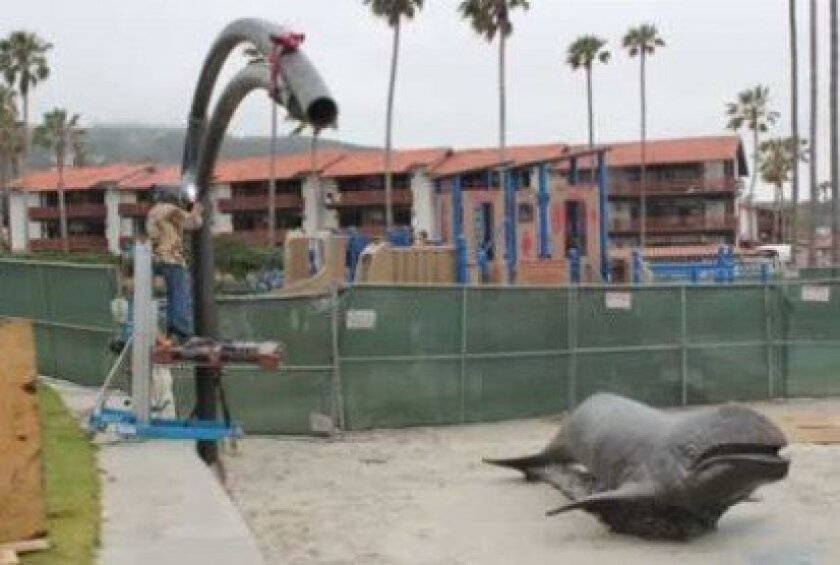 Work was underway this week on a  $40,000 structure that will provide shade to the bronze statue of J. J. the gray whale at Kellogg Park. Pat Sherman photos