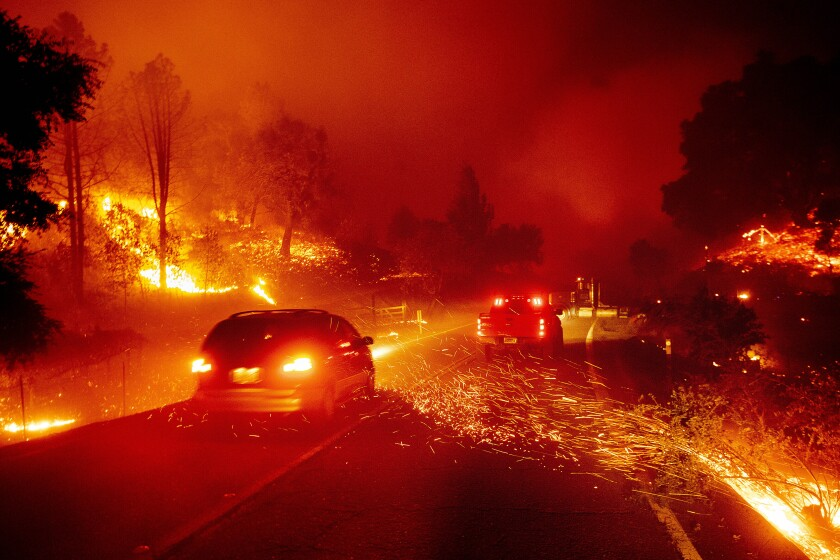 Embers fly across a roadway as the Kincade Fire burns through Sonoma County on Thursday.