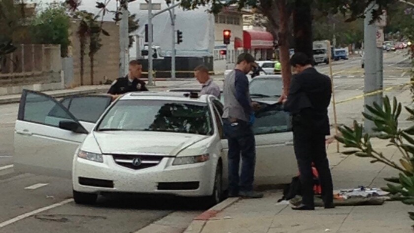 Authorities look over the suspect's car in Santa Monica.