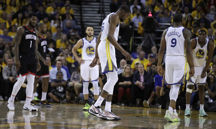 Golden State Warriors center Kevin Durant limps off the court during the second half of Game 5 of the NBA Western Conference semifinals.