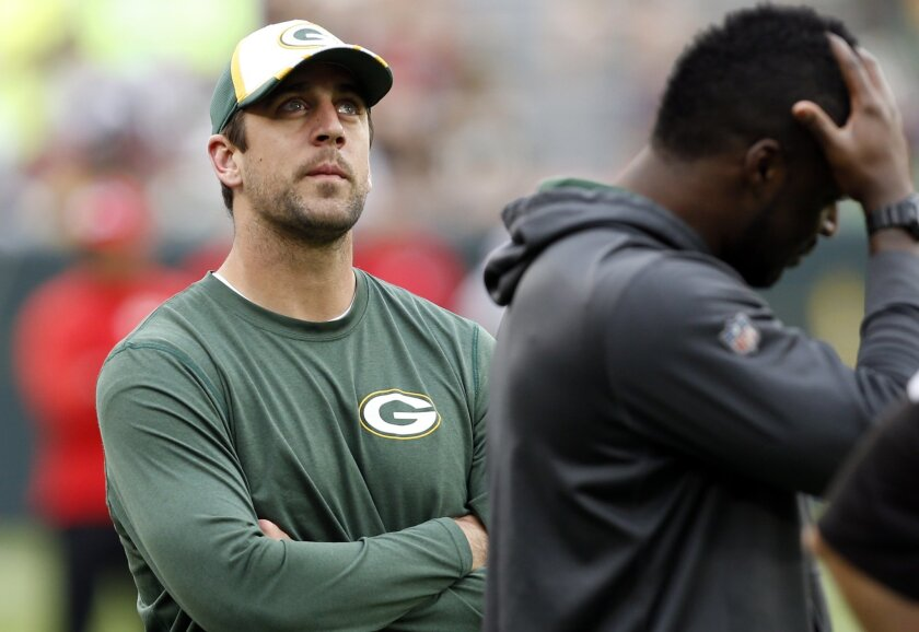 Green Bay Packers quarterback Aaron Rodgers watches teammates warm-up before an NFL football preseason game against the Kansas City Chiefs Thursday, Aug. 28, 2014, in Green Bay, Wis. Rodgers and other starters are not expected to play in the game. (AP Photo/Mike Roemer)