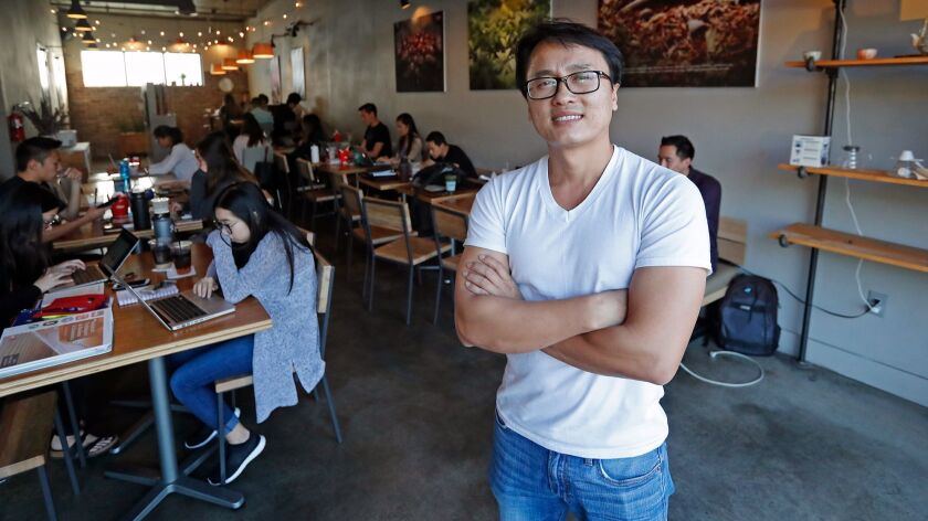 Co-owner Sonny Nguyen, 38, poses for a portrait at 7 Leaves Cafe in Garden Grove. Little Saigon is i