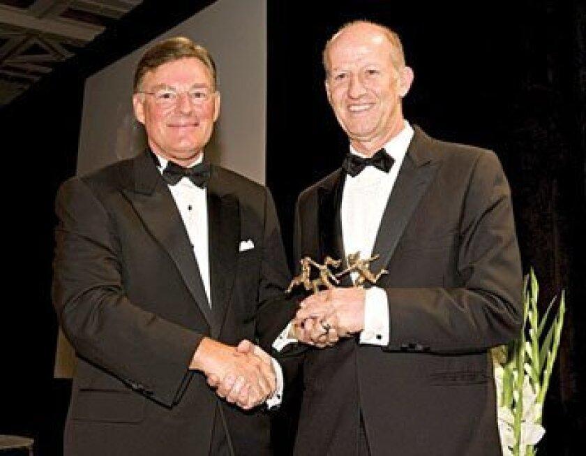 Harold McGraw (left) congratulates Larry Rosenstock. Photo courtesy McGraw-Hill