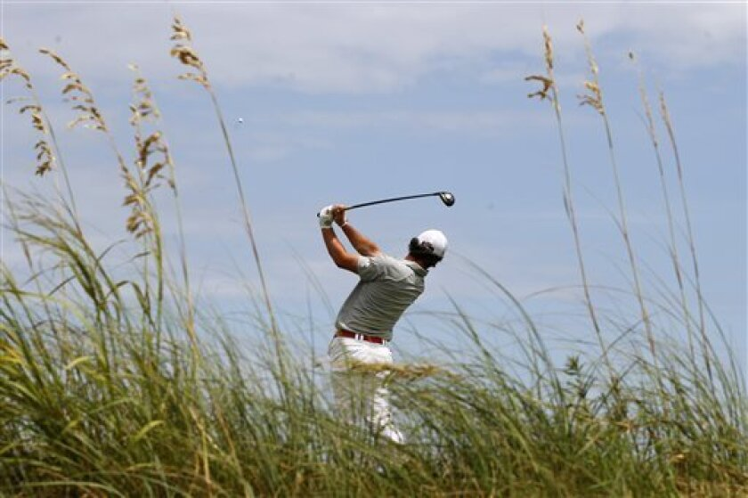 Rory McIlroy, of Northern Ireland, watches his drive from the fourth tee during the second round of the PGA Championship golf tournament on the Ocean Course of the Kiawah Island Golf Resort in Kiawah Island, S.C., Friday, Aug. 10, 2012. (AP Photo/Chuck Burton)