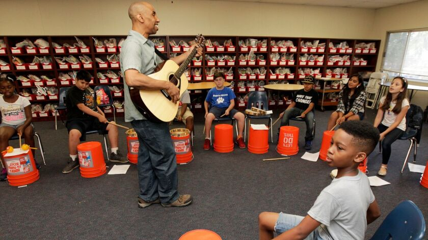 """John """"J.J."""" Brown holds a music class attended by students from seven schools at Webster Elementary"""