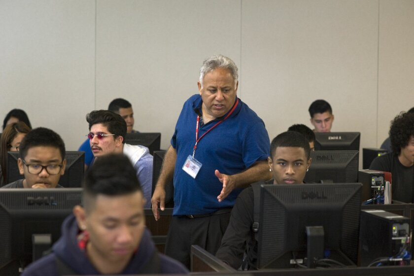 Art Lopez, a teacher at Sweetwater High School, reviews students' work during a computer science class on August 14, 2015 in National City, California..Photo - David Maung