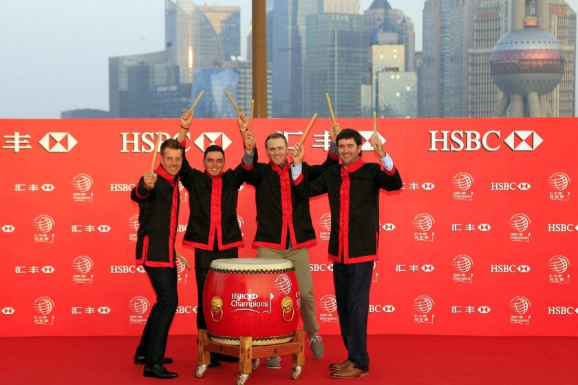 From left to right, golf players Henrik Stenson, Rickie Fowler, Jordan Spieth, Bubba Watson, hold drum sticks for a photo during the HSBC Champions golf tournament photocall in Shanghai, China Tuesday Nov. 3, 2015. (AP Photo)