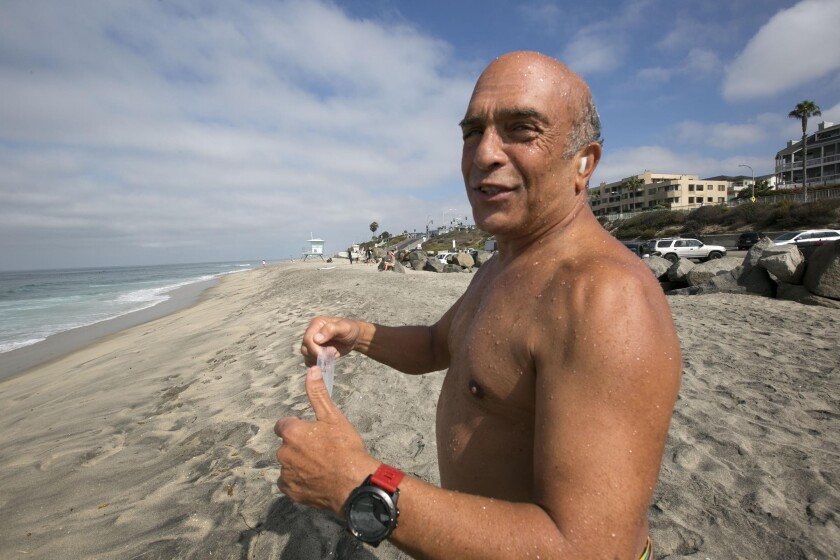 Jamshid Khajavi, 66, will aim for his fifth official solo swim across the Catalina Channel on Wednesday night. On Monday morning, Sept. 23, 2019, he tried out all of the different swim goggles that he will use during the crossing at Tamarack State Beach in Carlsbad.