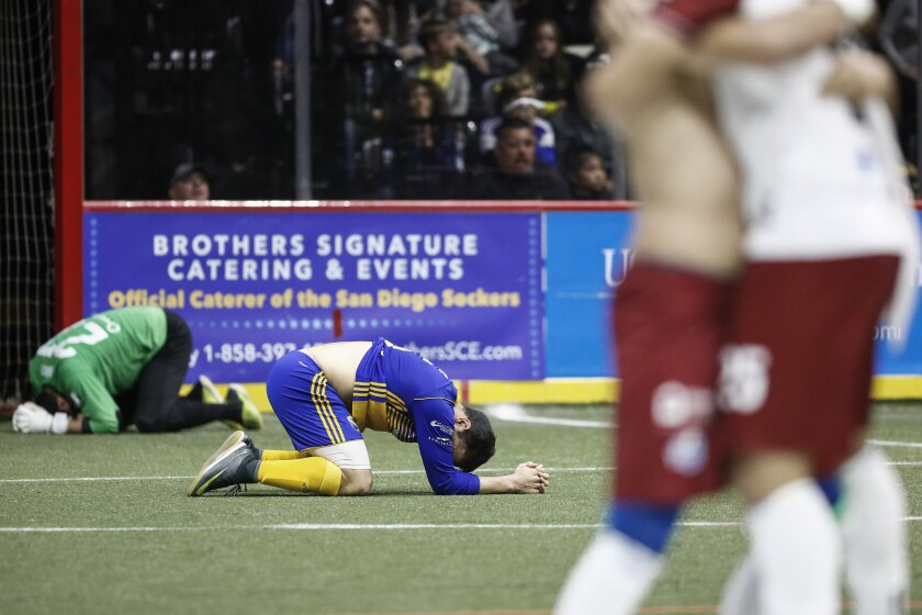 Sockers players lay on the field in disappointment after their overtime loss to Monterrey in the Western Conference Final.