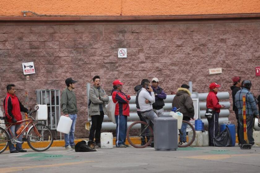 Consumers continue to wait in line to get a gasoline ration, in Mexico City, Mexico, 14 January 2019. Last week, Mexican President Andres Manuel Lopez Obrador changed the state oil company Pemex's supply model from pipelines to tanker trucks in order to battle fuel theft but the change in the distribution chain led to fuel shortages and panic purchases. EPA-EFE/Sashenka Gutierrez