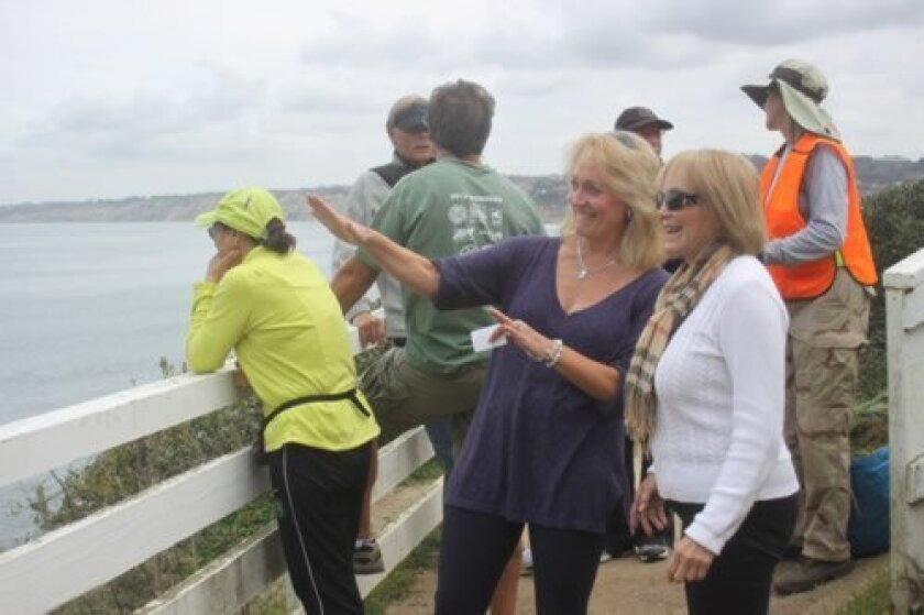 Friends of Coast Walk founders Brenda Fake and Linda Fisler (foreground) point out planned improvements.