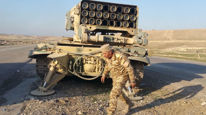 An Iraqi officer prepares a rocket launcher for attacks on west Mosul.