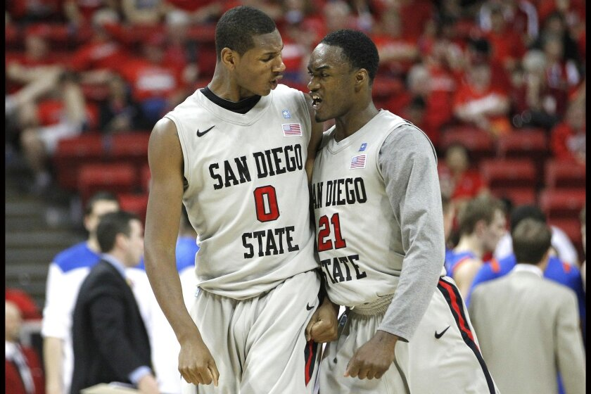Skylar Spencer (left) and Jamaal Franklin get fired up as they shoot down the Broncos late in the game.