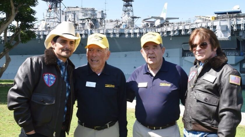 Midway Museum docents, Ev Southwick, center left, next to Jack Ensch, were both POWs during the Viet