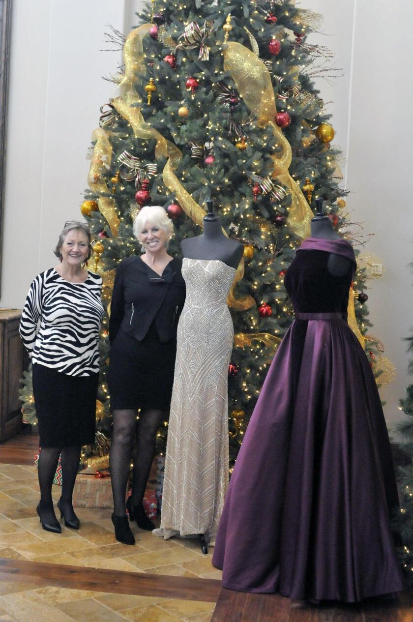 Las Damas de Fairbanks President Vicki Barclay, Dreamkeepers Project President Sandi Chenoweth, designer fashions from www.miabellacouture.com