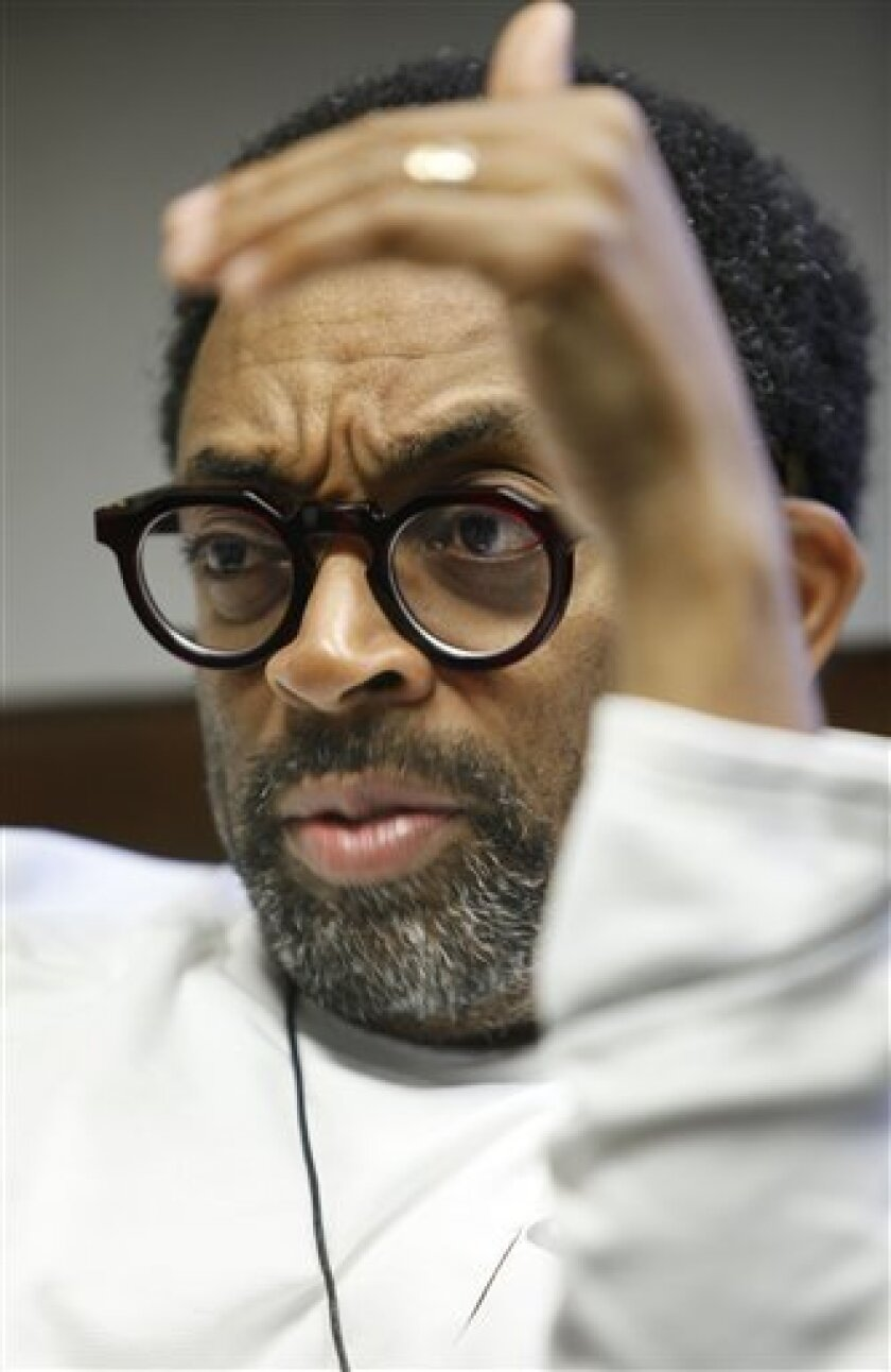 """In this June 15, 2009 photo, film director Spike Lee responds during an interview in New York about his 1989 film """"Do The Right Thing.""""  (AP Photo/Seth Wenig)"""