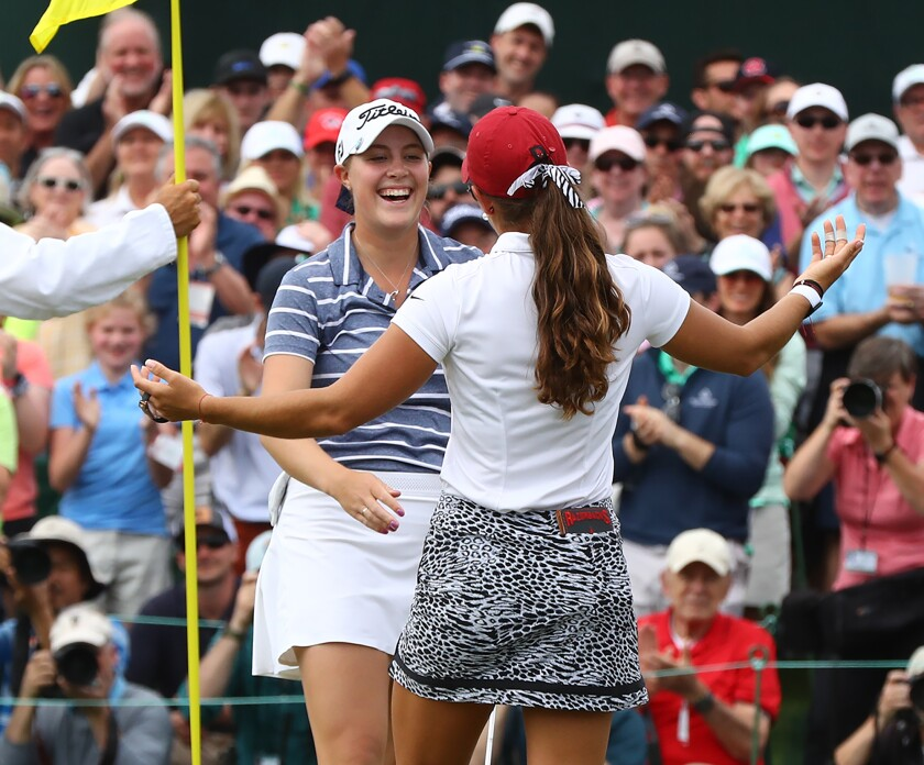 Jennifer Kupcho (left) gets a hug from Maria Fassi after sinking her birdie putt on the 18th green to win the inaugural Augusta National Women's Amateur at Augusta National Golf Club on Saturday, April 6, 2019, in Augusta, Ga.