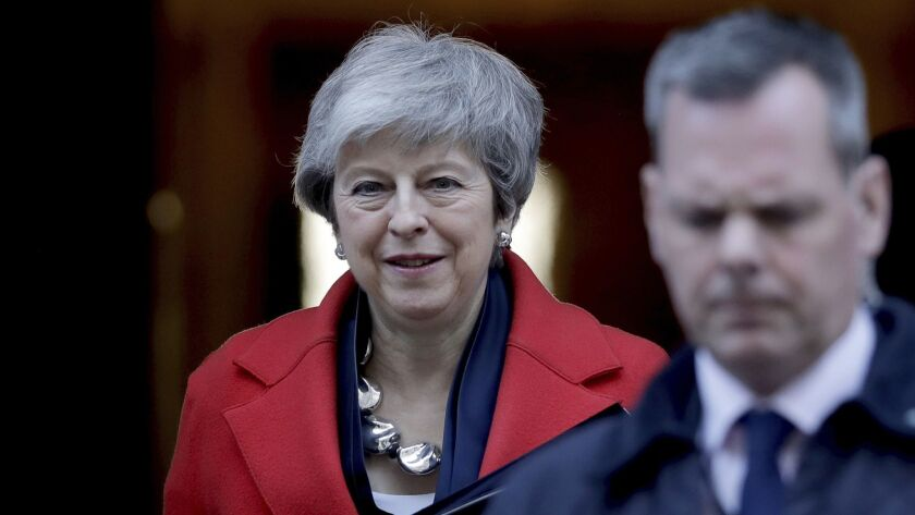 Britain's Prime Minister Theresa May leaves 10 Downing Street to make a statement to the Houses of P