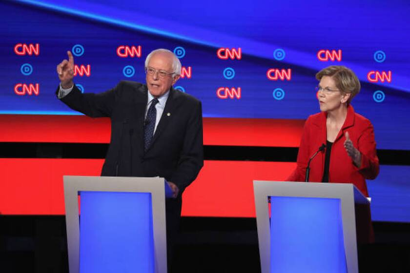 """Sens. Bernie Sanders and Elizabeth Warren are two of the leading backers of """"Medicare for all"""" plans that would eliminate job-based insurance in favor of a government-run plan."""