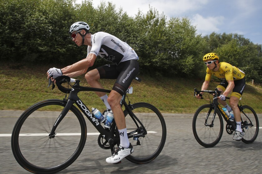 FILE - In this July 27, 2018 file photo, Britain's Chris Froome, left, and Britain's Geraint Thomas, wearing the overall leader's yellow jersey, climb Col d'Aspin pass during the nineteenth stage of the Tour de France cycling race over 200.5 kilometers (124.6 miles) with start in Lourdes and finish in Laruns, France. Four-time champion Chris Froome is making his return at the Tour de France for the first time in three years. Now riding for the Israel Start-Up Nation team, Froome does not have personal ambitions and will ride in support of leader Michael Woods. Froome missed the last two editions of the three-week race following a career-threatening crash. (AP Photo/Christophe Ena, File)
