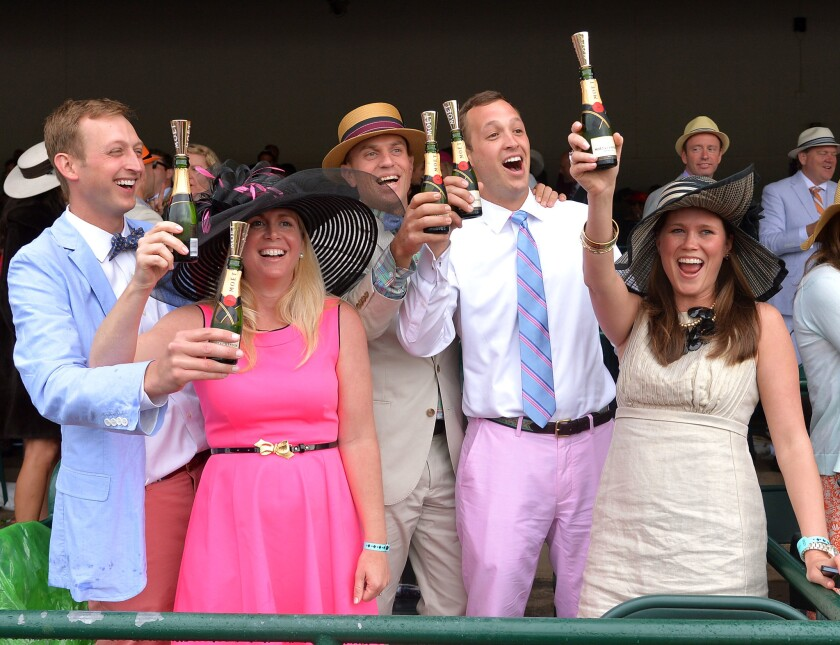 Raise a glass, like these guests of the 139th Kentucky Derby, during this year's Junior League of San Diego Food & Wine Festival.