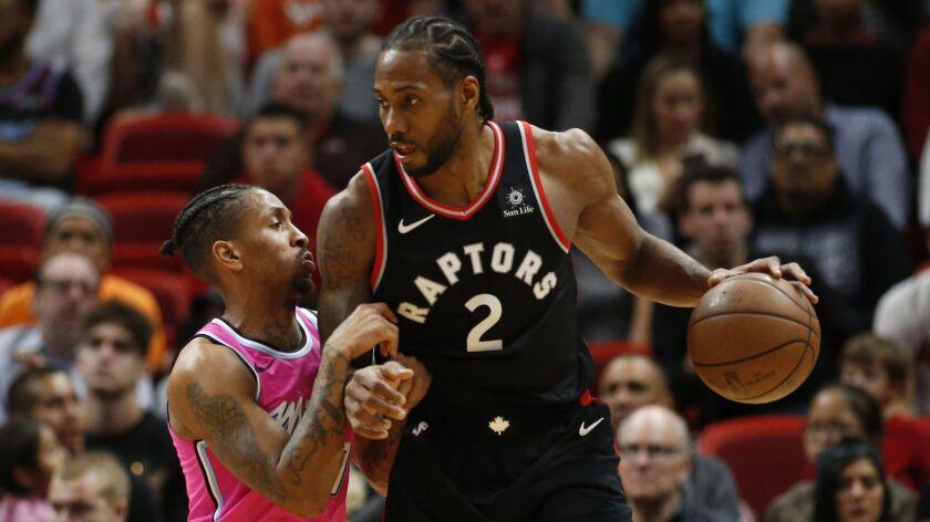 Miami Heat guard Rodney McGruder (17) defends against Toronto Raptors forward Kawhi Leonard (2) during the second half.