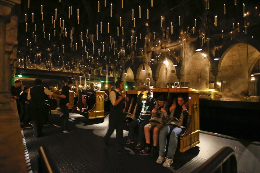 Candlesticks float and hover above the riders aboard Harry Potter and The Forbidden Journey in the new Wizarding World of Harry Potter at Universal Studios Hollywood. The attraction opens to the general public April 7.
