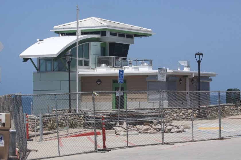 Work must temporarily cease on the Children's Pool lifeguard tower, which is nearly complete.