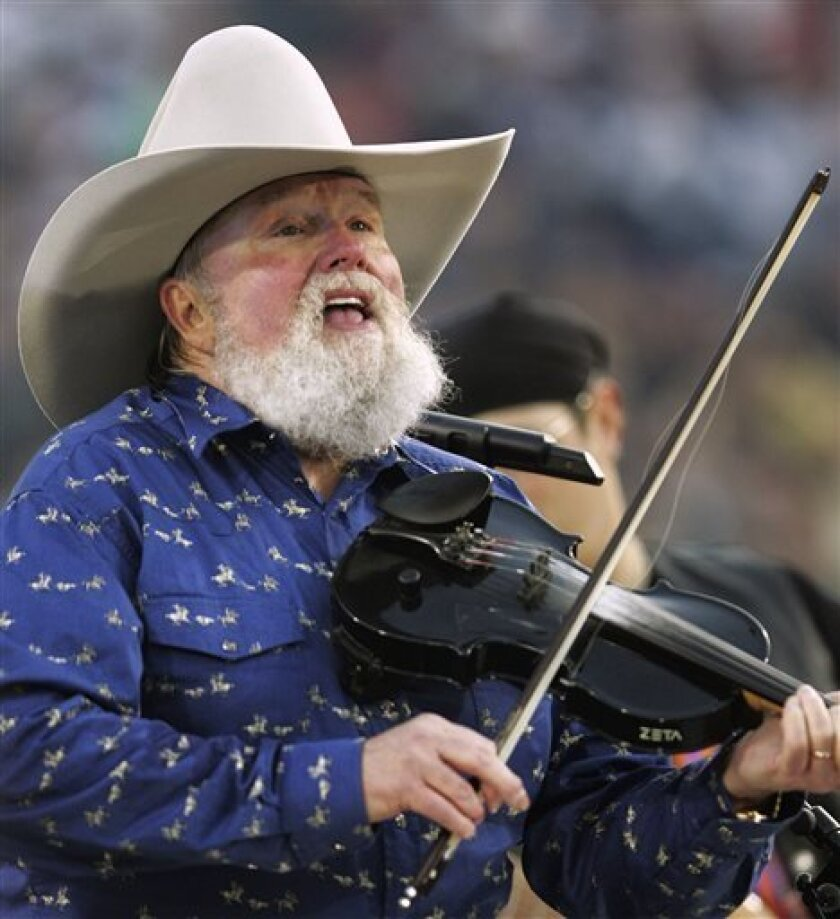In this Feb. 6, 2005 file photo, Charlie Daniels performs during pre-game festivities before Super Bowl XXXIX