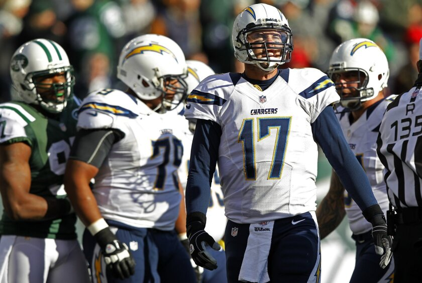 Chargers Philip Rivers grimaces after getting sacked by Jets Quinton Coples on Sunday, Dec. 23, 2012.