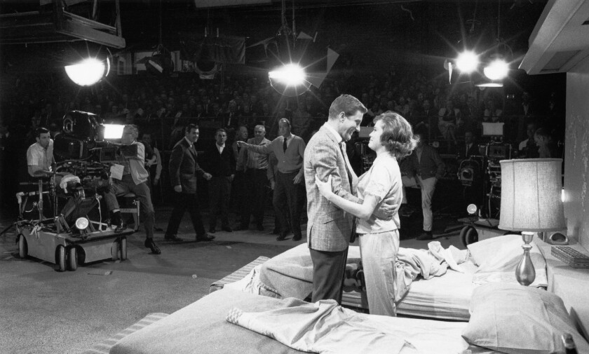 """Dick Van Dyke and Mary Tyler Moore perform in front of a studio audience, multiple cameras and producers during a taping of """"The Dick Van Dyke Show."""""""