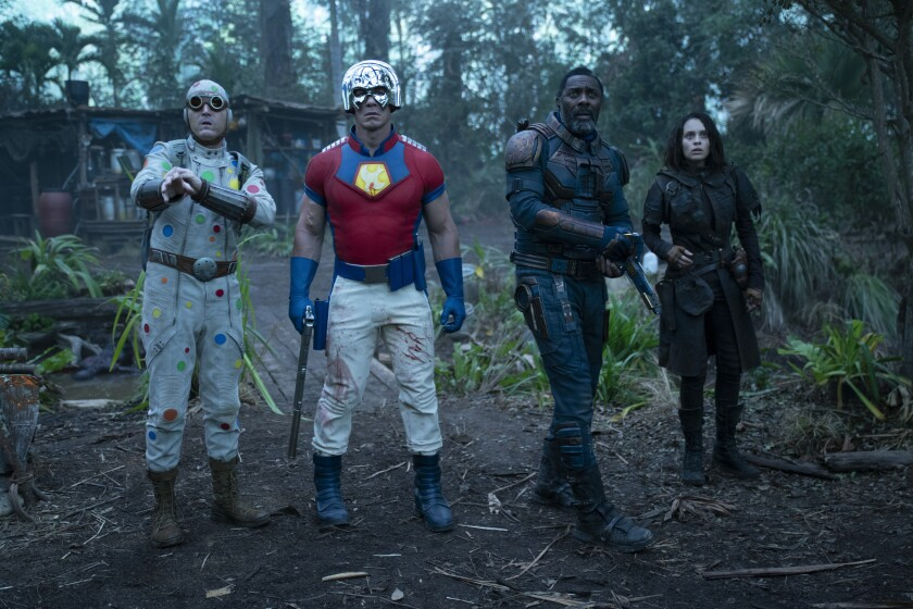 """This image provided by Warner Bros. Pictures shows David Dastmalchian, from left, John Cena, Idris Elba and Daniela Melchior in a scene from """"The Suicide Squad."""" (Jessica Miglio/Warner Bros. Pictures via AP)"""